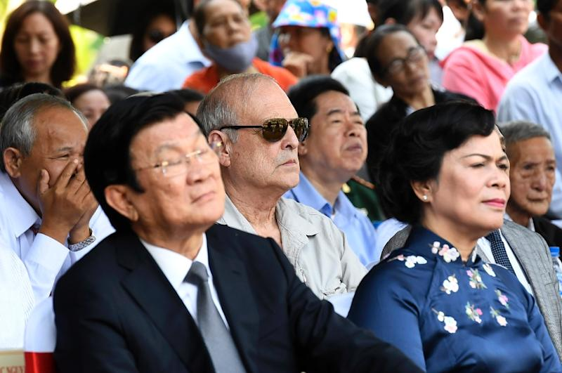 Ronald Haeberle (C- with sunglasses) said he came back to My Lai to repent for the horrors of the Vietnam War's deadliest massacre (AFP Photo/NHAC NGUYEN)