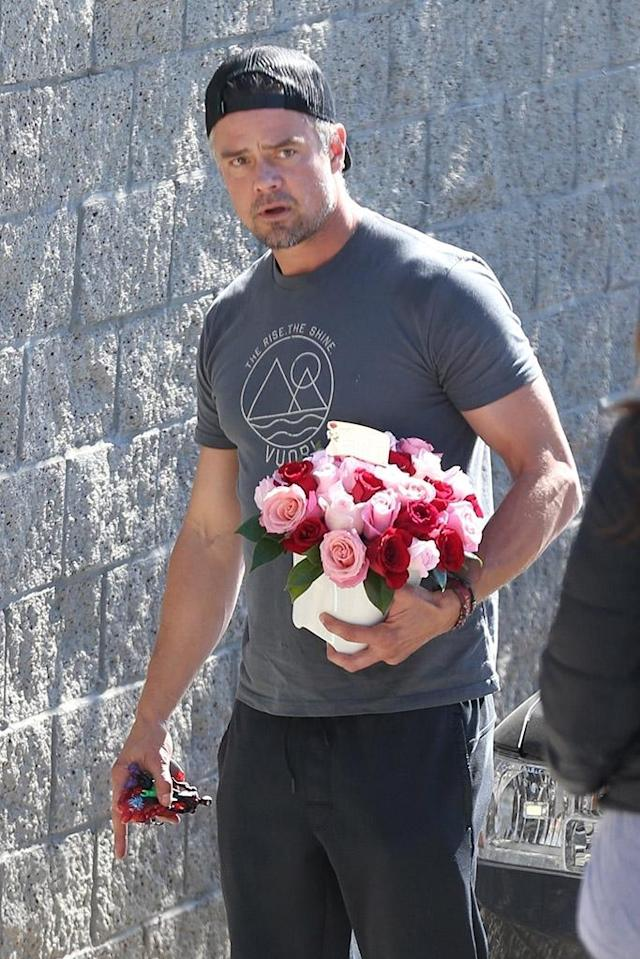 <p>The <em>Transformers</em> star looked to comfort his estranged wife Fergie by bringing her flowers on Monday, after her performance of the national anthem at the NBA All-Star Game, which was met with less-than-stellar reviews. (Photo: Wago/BackGrid)<br><br></p>