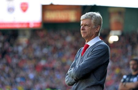 FILE PHOTO: Former Arsenal manager Arsene Wenger looks on. REUTERS/Peter Powell