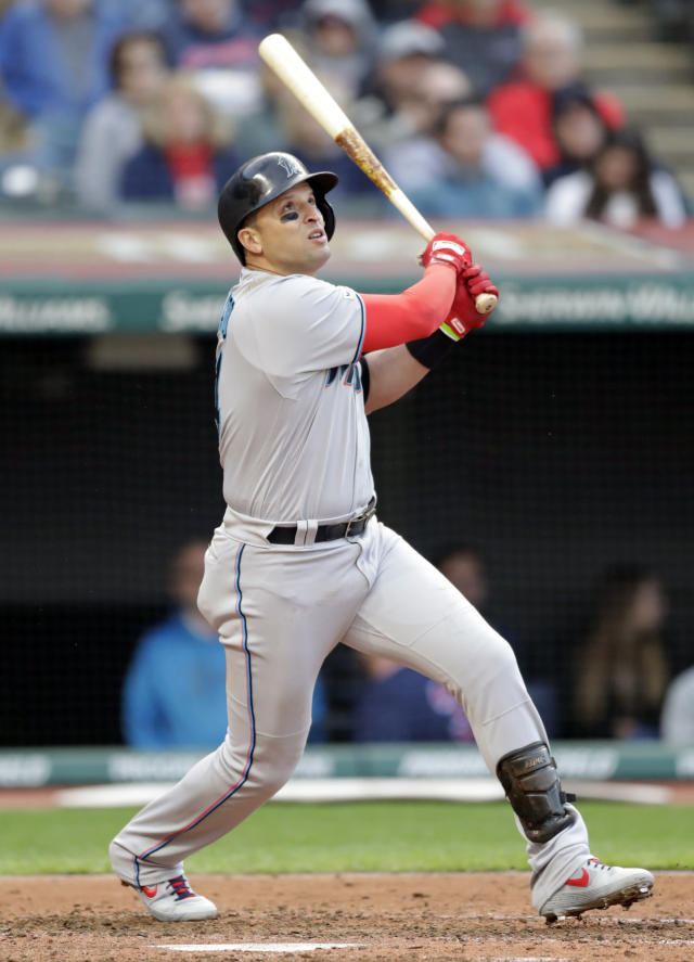Miami Marlins' Martin Prado watches his ball after hitting a sacrifice fly in the fifth inning of a baseball game against the Cleveland Indians, Tuesday, April 23, 2019, in Cleveland. Jon Berti scored on the play. (AP Photo/Tony Dejak)