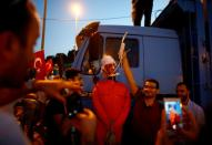 FILE PHOTO: A man poses with an effigy of U.S.-based Turkish cleric Fethullah Gulen during a ceremony marking the first anniversary of the attempted coup at the Bosphorus Bridge in Istanbul