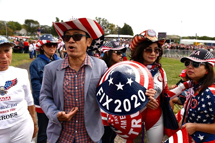 """A Vietnamese American supporter of former President Donald Trump from Los Angeles explains why his family changed their name from Tran to Trump at the Iowa State Fairgrounds in Des Moines on Oct. 9. """"When you have a king that really works hard, the people take over his last name, """" T. Trump says."""