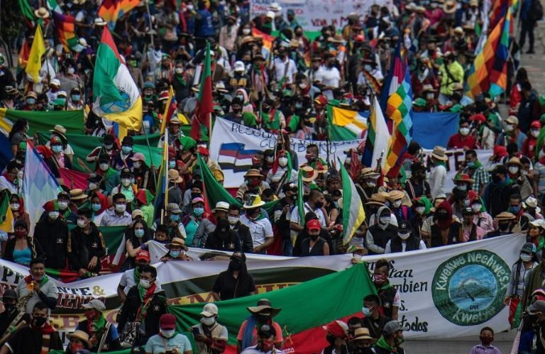 """Colombian indigenous people demonstrate against the government in the framework of a """"Minga"""" (indigenous meeting) in Bogota, on October 19, 2020"""