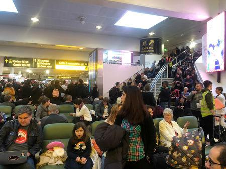 Stranded passengers wait at Gatwick Airport, Britain, December 20, 2018 in this picture obtained from social media. Ani Kochiashvili/via REUTERS