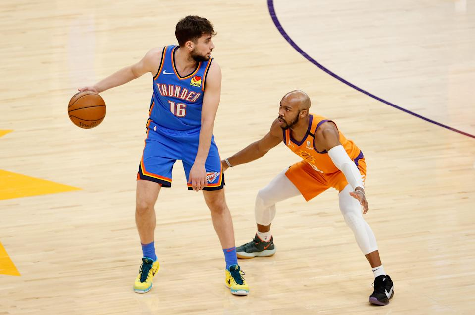 PHOENIX, ARIZONA - APRIL 02: Ty Jerome #16 of the Oklahoma City Thunder handles the ball against Jevon Carter #4 of the Phoenix Suns during the NBA game at Phoenix Suns Arena on April 02, 2021 in Phoenix, Arizona. The Suns defeated the Thunder 140-103. NOTE TO USER: User expressly acknowledges and agrees that, by downloading and or using this photograph, User is consenting to the terms and conditions of the Getty Images License Agreement.