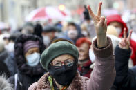 A woman wearing a face mask to protect against coronavirus gestures as she attends a pensioners' opposition rally to protest the official presidential election results in Minsk, Belarus, Monday, Nov. 16, 2020. Crowds of retirees marched down the streets of the Belarusian capital on Monday, demanding the resignation of the country's authoritarian president and to end the government crackdown on peaceful protesters. (AP Photo)