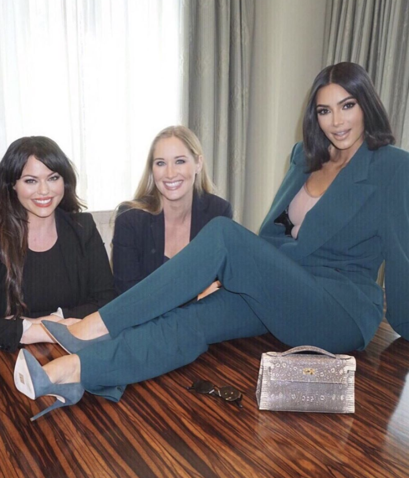 Kim Kardashian posed on a table in the photos she shared. (Photo: Instagram via Kim Kardashian)