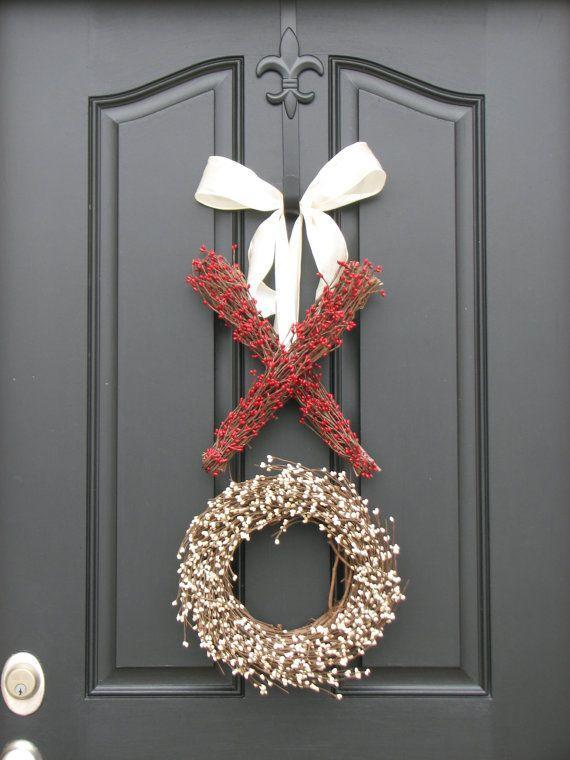 "<p>You don't need an over-the-top wreath stuffed to the brim with red and pink flowers to bring the V-day spirit to your front door. This <span class=""redactor-unlink"">subtle X and O wreath</span> does the trick just fine without any overly romantic kitsch.</p><p><em>Via <a href=""https://www.etsy.com/listing/91828112/berry-wreath-valentines-day-wreath"" rel=""nofollow noopener"" target=""_blank"" data-ylk=""slk:Etsy"" class=""link rapid-noclick-resp"">Etsy</a> </em> </p><p><a class=""link rapid-noclick-resp"" href=""https://go.redirectingat.com?id=74968X1596630&url=https%3A%2F%2Fwww.etsy.com%2Flisting%2F89489847%2Fvalentine-wreath-sale-valentines-day%3Fga_order%3Dmost_relevant%26ga_search_type%3Dall%26ga_view_type%3Dgallery%26ga_search_query%3Dxo%2Bwreath%26ref%3Dsr_gallery-1-1%26organic_search_click%3D1%26bes%3D1%26col%3D1&sref=https%3A%2F%2Fwww.elledecor.com%2Flife-culture%2Ffun-at-home%2Fg2387%2Fvalentines-day-decor%2F"" rel=""nofollow noopener"" target=""_blank"" data-ylk=""slk:GET THE LOOK"">GET THE LOOK</a><br><em>XO Wreath, Etsy, $110</em></p>"