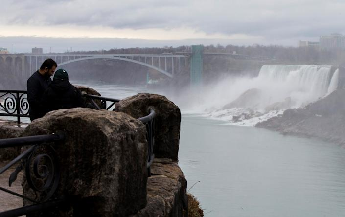 NIAGARA FALLS, March 31, 2021 -- Visitors are seen at the Canadian side of Niagara Falls, Ontario, Canada, on March 31, 2021. Canada's tourism spending was cut 48.1 percent in 2020 and tourism gross domestic product GDP plunged 47.9 percent, Statistics Canada said Wednesday. (Photo by Zou Zheng/Xinhua via Getty) (Xinhua/Zou Zheng via Getty Images)