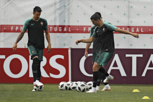 Portugal's Cristiano Ronaldo, right, plays the ball with teammates during Portugal's official training on the eve of the group B match between Portugal and Morocco at the 2018 soccer World Cup, in Kratovo, outskirts Moscow, Russia, Tuesday, June 19, 2018. (AP Photo/Francisco Seco)