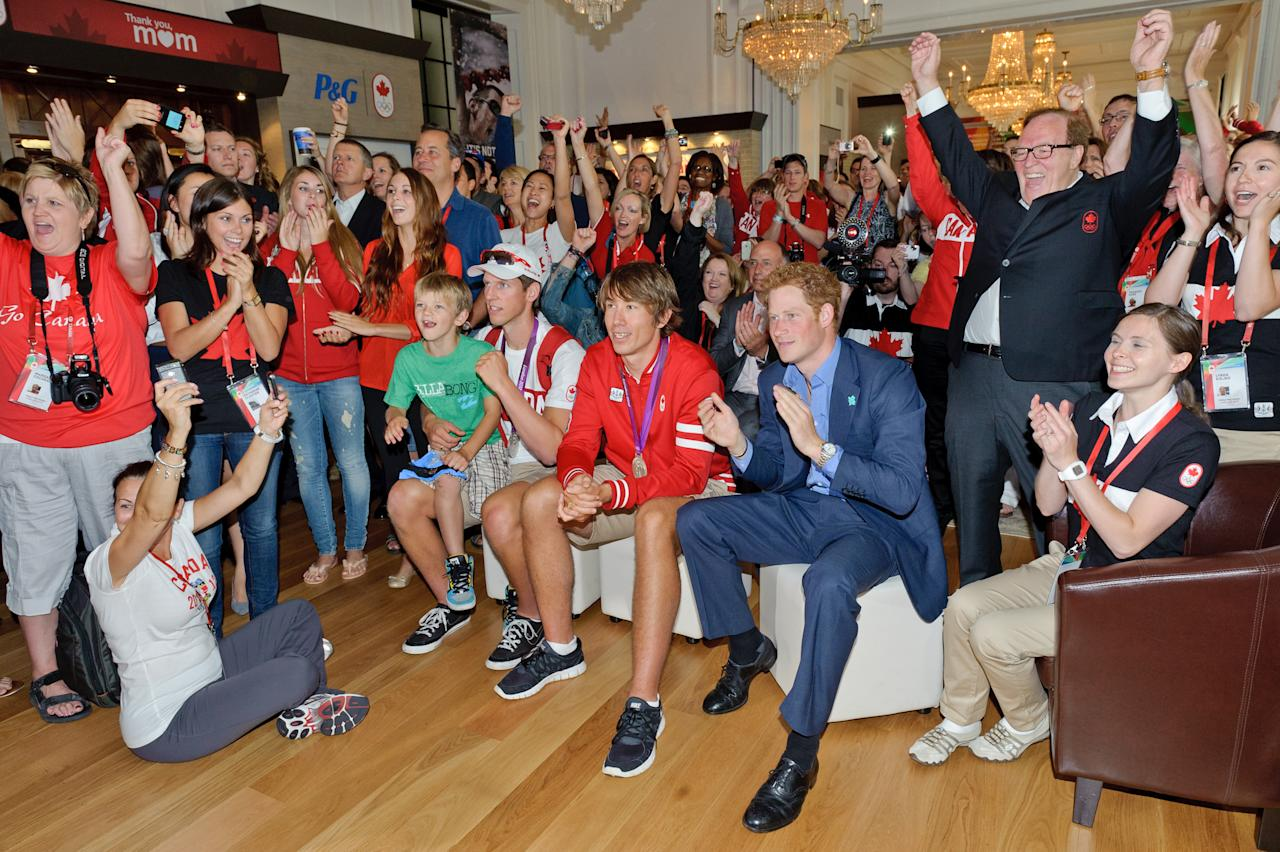 Prince Harry joins Canadian Olympians, families, officials and Olympic Committee members in celebrating Canada's silver medal in the women's 8 rowing competition at Canada Olympic House, London, Thursday Aug. 2, 2012. (Canadian Olympic Committee Photo)