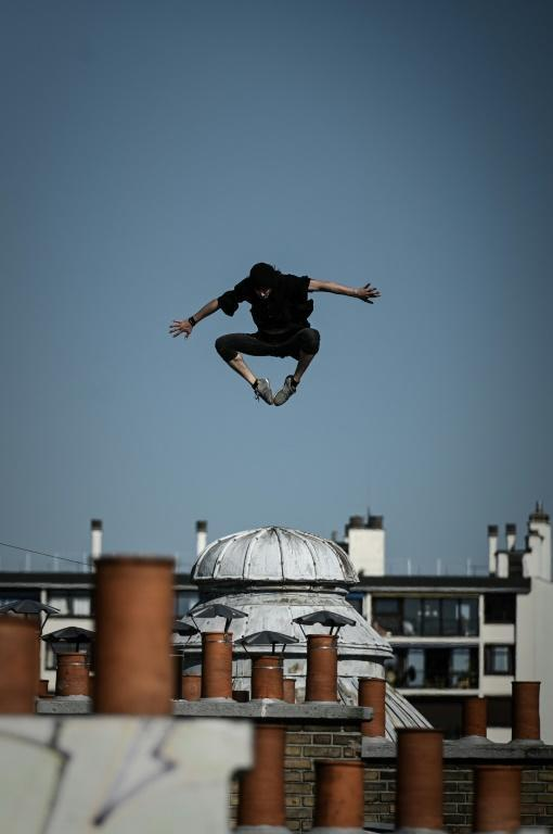 Up on the roof: Nogueira leaps across the Paris skyline