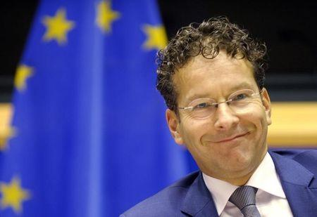 Dutch Finance Minister and Eurogroup chairman Dijsselbloem smiles during a news conference at the European Parliament in Brussels