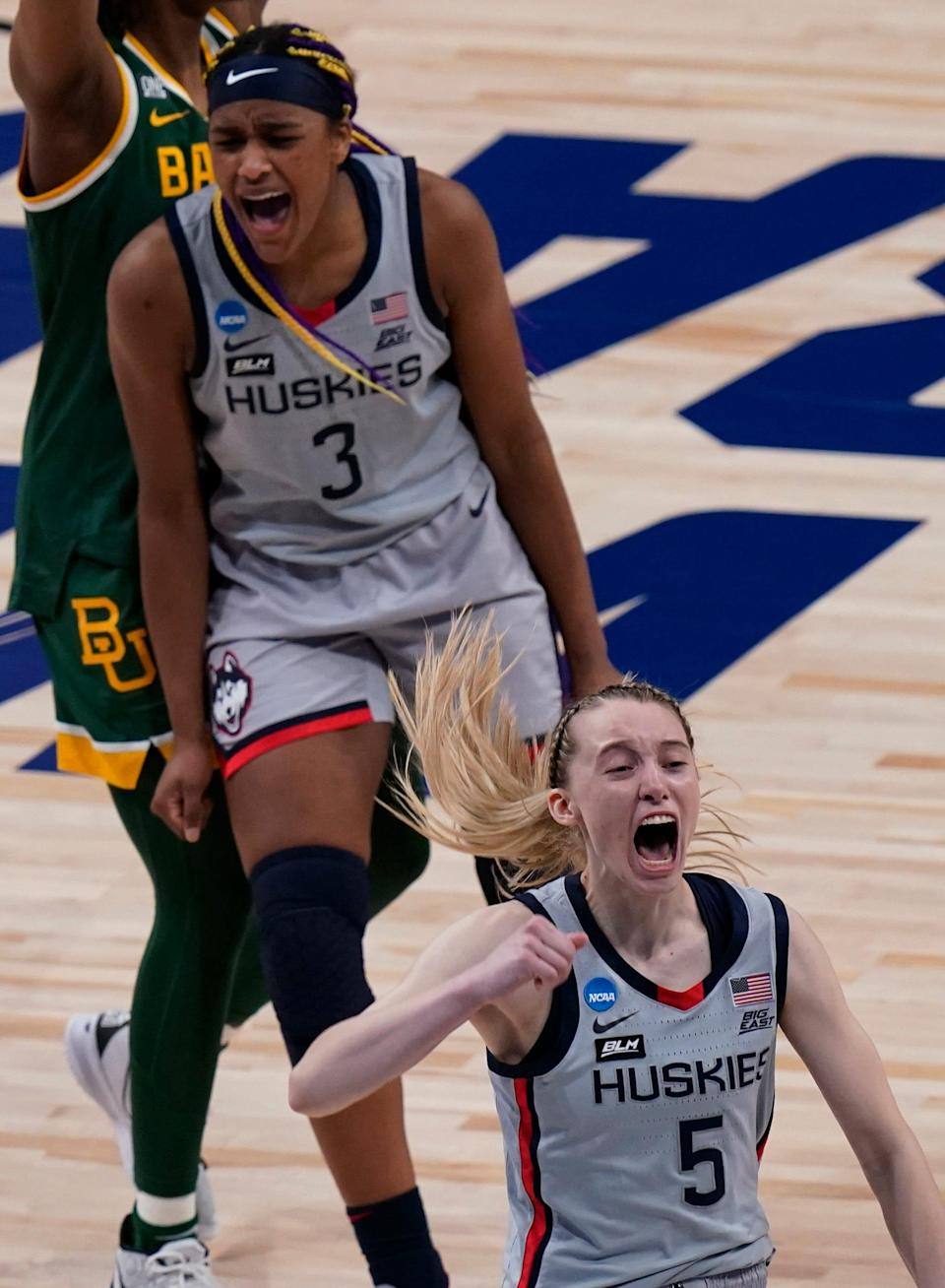 Paige Bueckers, right, and Aaliyah Edwards celebrate UConn's victory over Baylor to reach the Final Four.