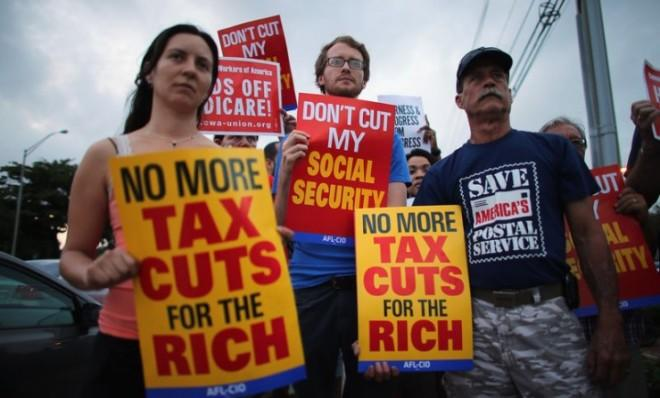 Protesters rally outside the office of Sen. Marco Rubio (R-Fla.) on Dec. 10, hoping that senators like Rubio don't cut benefits like Medicare in fiscal-cliff talks.