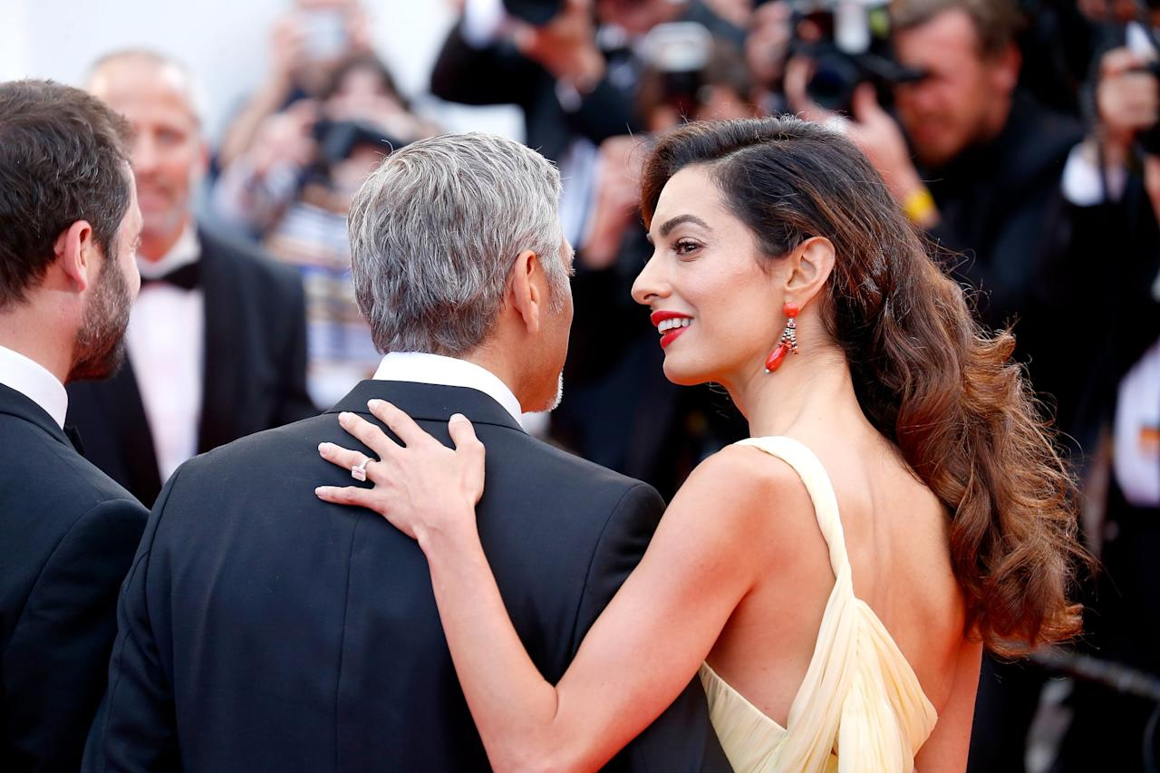 """<p>When Amal joined her husband on the red carpet in May 2016 at the Cannes Film Festival, her engagement ring accessorized <a href=""""https://www.popsugar.com/fashion/Amal-Clooney-Dress-Cannes-Money-Monster-Premiere-41292008"""" class=""""ga-track"""" data-ga-category=""""Related"""" data-ga-label=""""https://www.popsugar.com/fashion/Amal-Clooney-Dress-Cannes-Money-Monster-Premiere-41292008"""" data-ga-action=""""In-Line Links"""">her yellow Atelier Versace gown</a>.</p>"""
