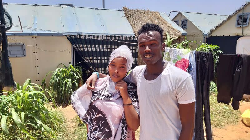 FILE PHOTO: Couple poses for a photograph outside their sleeping quarters in Hamdallaye refugee camp