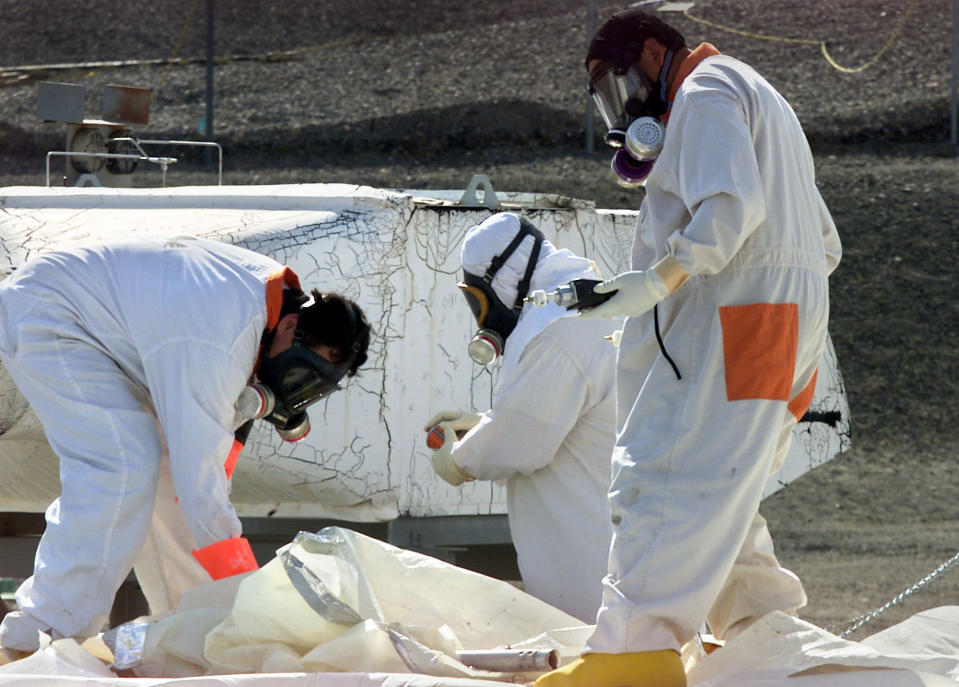FILE -- In this March 23, 2004 file photo, workers at the tank farms on the Hanford Nuclear Reservation near Richland, Wash., measure for radiation and the presence of toxic vapors. A nuclear safety board has warned a key U.S. senator that underground tanks holding radioactive waste at the nation's most contaminated nuclear site pose a possible risk of explosion. Concerns that hydrogen gas could build up inside the tanks and lead to an explosion at south-central Washington state's Hanford Nuclear Reservation have been known for some time.(AP Photo/Jackie Johnston, File)