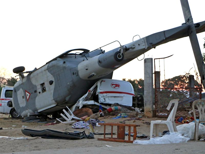 The remains of the military helicopter that fell on a van in Santiago Jamiltepec: Patricia Castellanos/AFP/Getty Images