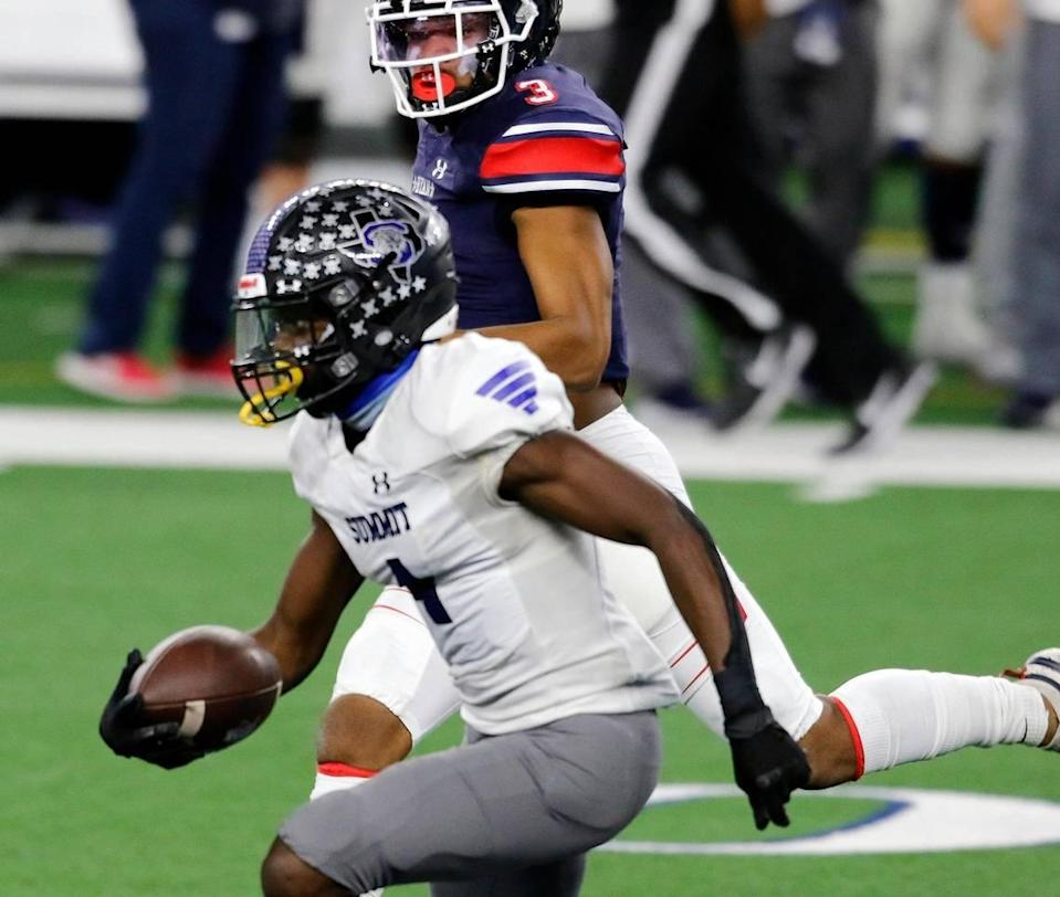Summit defensive back Jalon Rock (4) runs with the ball chased by Denton Ryan wide receiver/defensive back Austin Jordan (3) during the Conference 5A Division 1 2020 state championship semi-final football game at AT&T Stadium in Arlington, Texas, Friday, Jan. 08, 2021. Denton Ryan defeated Mansfield Summit 49-35 to advance to the state title game. (Special to the Star-Telegram Bob Booth)