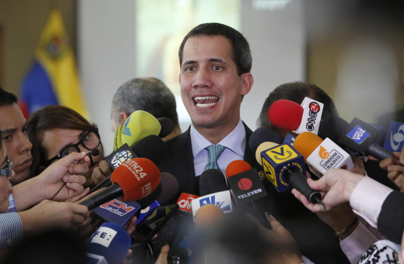 Venezuela's opposition leader and self-proclaimed interim President of Venezuela, Juan Guaidó, speaks to the press at the administrative headquarters of the National Assembly in Caracas, Venezuela, Tuesday, Sept. 3, 2019. Guaidó announced he will allow the use of satellite technology to facilitate the location and detection of irregular Colombian groups that might be in Venezuela, adding he has already started cooperating with Colombia's government to locate those organizations. (AP Photo/Andrea Hernandez Briceño)