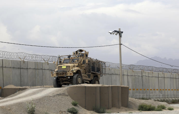 """A Mine Resistant Ambush Protected vehicle, MRAP, is parked after the American military left Bagram air base, in Parwan province north of Kabul, Afghanistan, Monday, July 5, 2021. The U.S. left Afghanistan's Bagram Airfield after nearly 20 years, winding up its """"forever war,"""" in the night, without notifying the new Afghan commander until more than two hours after they slipped away. (AP Photo/Rahmat Gul)"""