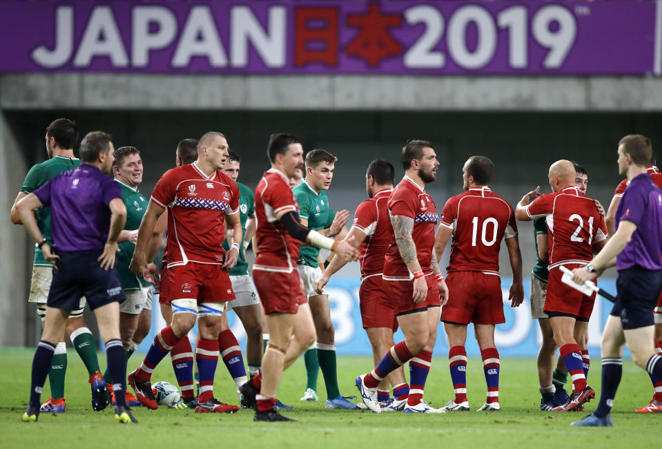 Russian and Ireland players shake hands following their Rugby World Cup Pool A game at Kobe Misaki Stadium in Kobe, Japan, Thursday, Oct. 3, 2019. Ireland defeated Russia 35-0. (AP Photo/Christophe Ena)