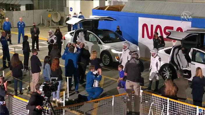 The four Crew-2 astronauts bid their families and friends farewell before being driven to the launch pad in SpaceX Tesla SUVs. / Credit: NASA TV