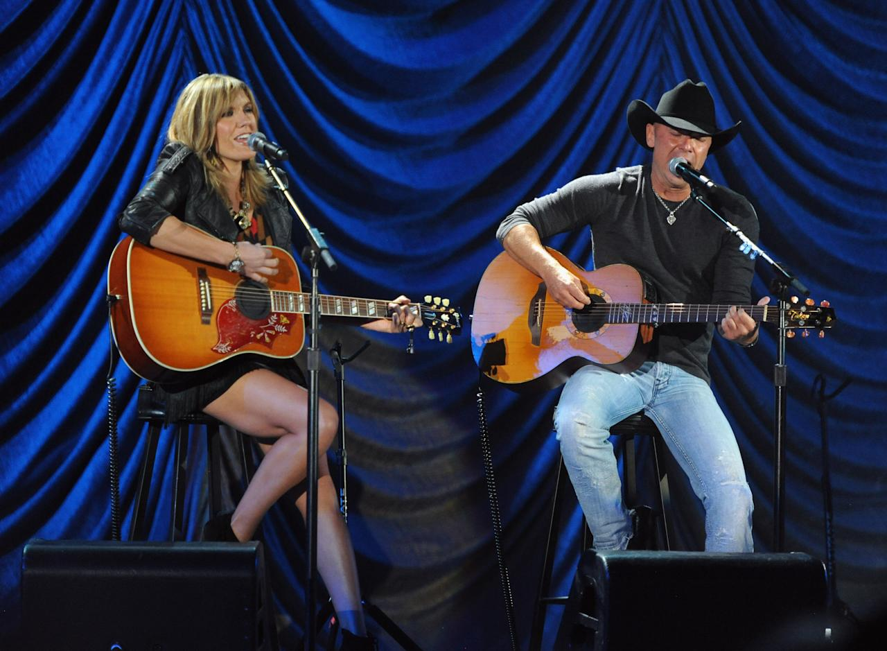 """LOS ANGELES, CA - OCTOBER 15:  (CALL FOR IMAGE, NO ARCHIVE, FOR EDITORIAL USE OF STORIES RELATED TO A DECADE OF DIFFERENCE: A CONCERT CELEBRATING 10 YEARS OF THE WILLIAM J. CLINTON FOUNDATION ONLY)  In this handout image provided by Getty Images, musicians Grace Potter and Kenny Chesney perform at """"A Decade of Difference:  A Concert Celebrating 10 Years of the William J. Clinton Foundation."""" The star-studded affair, a charitable event organized to raise awareness around Clinton Foundation's efforts to improve global health, strengthen economies worldwide, promote healthier childhoods, and protect the environment, was held at the iconic Hollywood Bowl on October 15, 2011 in Los Angeles, California.  (Photo by Kevin Mazur/Getty Images for Control Room)"""