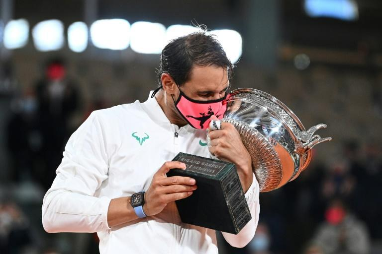 Looks familiar: Rafael Nadal kisses the trophy after defeating Novak Djokovic in the 2020 final