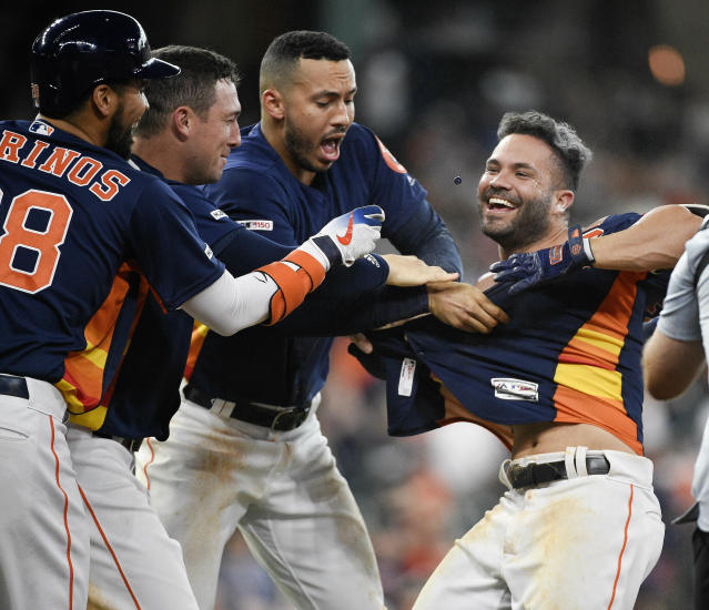 Houston Astros' Jose Altuve, right, celebrates his walk with the bases loaded to win the game during the ninth inning of a baseball game against the Oakland Athletics, Sunday, April 7, 2019, in Houston. (AP Photo/Eric Christian Smith)