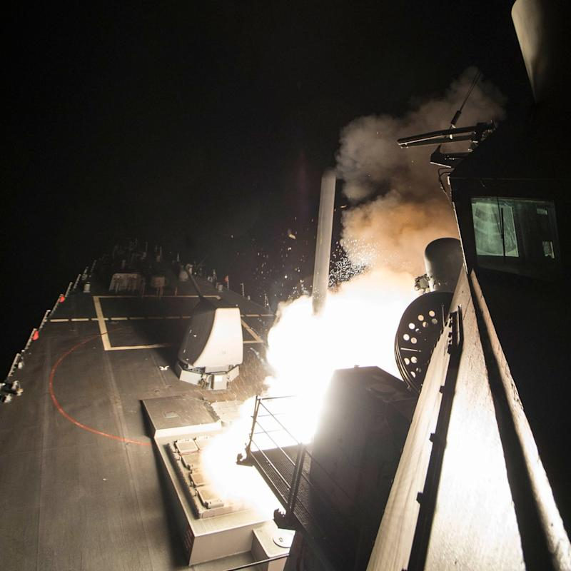 Image released by US Navy shows a Tomahawk missile being launched from a warship in the Mediterranean Sea - Credit: ROBERT S. PRICE/AFP