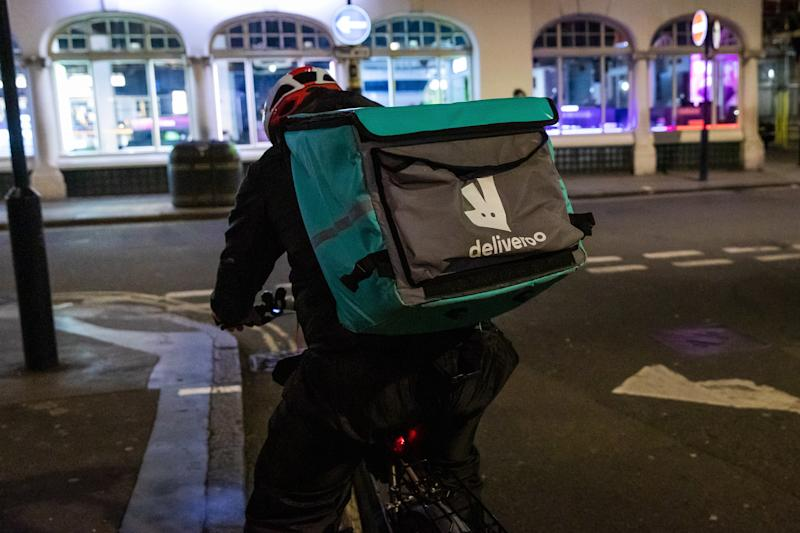 Picture of a Deliveroo delivery driver on the street in Soho in London, Britain, 20 March 2020. British Prime Minister Boris Johnson has ordered cafes, bars, restaurants and gyms to close tonight in an attempt to mitigate the spread of coronavirus and COVID-19.