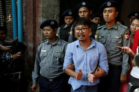 Detained Reuters journalist Wa Lone speaks to the media, while escorted by police, after a court hearing in Yangon, Myanmar May 22, 2018. REUTERS/Ann Wang