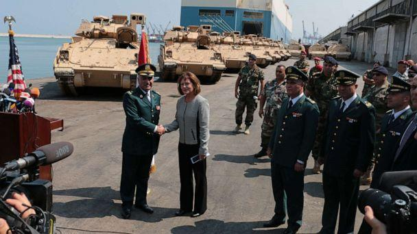PHOTO: Elizabeth Richard, U.S. Ambassador to Lebanon, right, and official army members attend a ceremony of armored military vehicles are unloaded from ships at Beirut's port in Lebanon on Aug. 14, 2017. (Anadolu Agency via Getty Images, FILE)