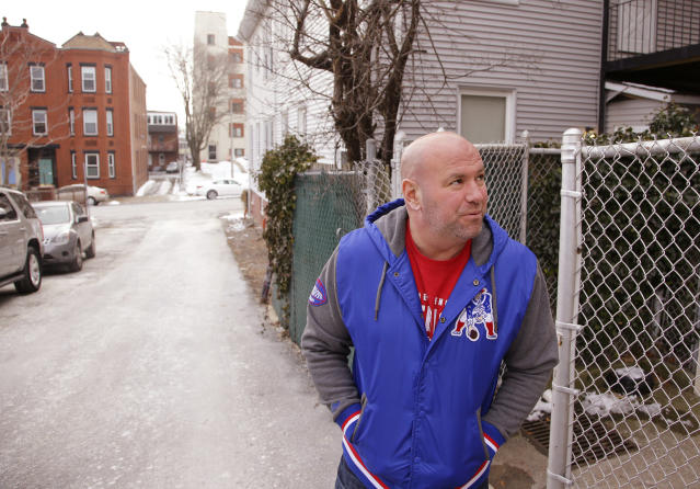 "In this Friday, Jan. 19, 2018 photo, Dana White, president of the Ultimate Fighting Championship, the largest mixed martial arts organization in the world, stands outside McDonough Gym, where he trained as a young fighter, in the ""Southie"" neighborhood of Boston. Long before he ran the UFC White was a ""Southie"" trying to make his way in boxing who dodged the money collectors for notorious crime boss Whitey Bulger that came knocking at his door. (AP Photo/Stephan Savoia)"