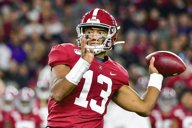 FILE - In this Nov. 9, 2019, file photo, Alabama quarterback Tua Tagovailoa plays in an NCAA football game in Tuscaloosa, Ala. Tagovailoa is a likely first round pick in the NFL Draft Thursday, April 23, 2020. (AP Photo/Vasha Hunt, File)