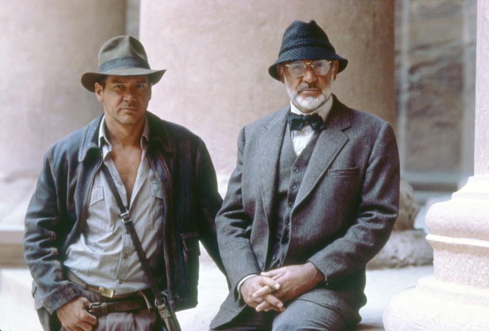 """Actors Harrison Ford and Sean Connery on the set of """"Indiana Jones and the Last Crusade"""". (Photo by Sunset Boulevard/Corbis via Getty Images)"""