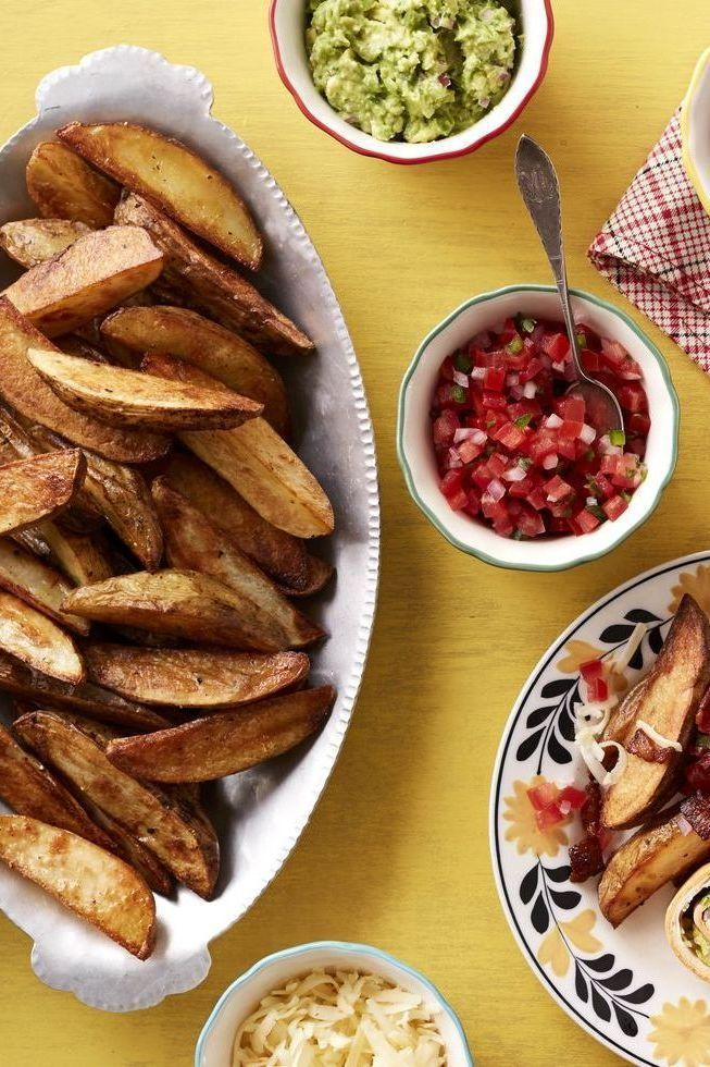 """<p>For those who are looking to get creative this Fourth of July, here's an idea: Set up a """"toppings bar"""" next to these gorgeous wedge fries, and let your guests pick and choose toppings.</p><p><strong><a href=""""https://www.thepioneerwoman.com/food-cooking/recipes/a34240013/loaded-wedge-fries/"""" rel=""""nofollow noopener"""" target=""""_blank"""" data-ylk=""""slk:Get the recipe"""" class=""""link rapid-noclick-resp"""">Get the recipe</a>.</strong></p><p><a class=""""link rapid-noclick-resp"""" href=""""https://go.redirectingat.com?id=74968X1596630&url=https%3A%2F%2Fwww.walmart.com%2Fbrowse%2Fhome%2Fthe-pioneer-woman-cookware%2F4044_623679_6182459_9190581&sref=https%3A%2F%2Fwww.thepioneerwoman.com%2Ffood-cooking%2Fmeals-menus%2Fg32157273%2Ffourth-of-july-appetizers%2F"""" rel=""""nofollow noopener"""" target=""""_blank"""" data-ylk=""""slk:SHOP COOKWARE""""><strong>SHOP COOKWARE</strong></a></p>"""