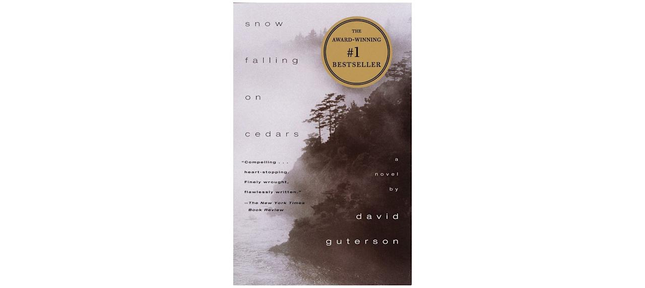 "<p>Set in the Pacific Northwest in the 1950s, this atmospheric novel tells the story of a man wrongfully accused of a crime. Not only is the subject of this novel important—it examines the racial tension between Japanese Americans and their white neighbors after World War II—its lush description gives the story a vivid sense of place.</p> <p><strong>To buy: </strong>$11, <a href=""https://www.amazon.com/Snow-Falling-Cedars-David-Guterson/dp/067976402X?ie=UTF8&camp=1789&creative=9325&linkCode=as2&creativeASIN=067976402X&tag=reasim03-20&ascsubtag=d41d8cd98f00b204e9800998ecf8427e"" target=""_blank"">amazon.com</a>.</p>"