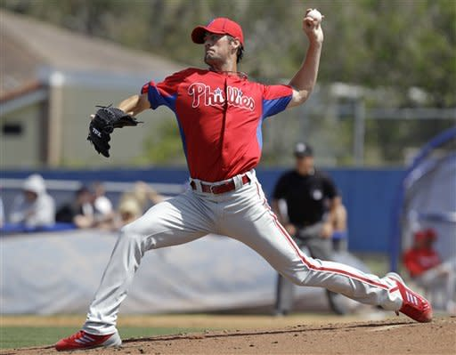 Philadelphia Phillies starting pitcher Cole Hamels winds up against the Toronto Blue Jays in the second inning of a spring training baseball game in Dunedin, Fla., Sunday, March 18, 2012. Hamel;s allowed five runs, four earned, on eight hits in three and 1/3 innings. (AP Photo/Kathy Willens)