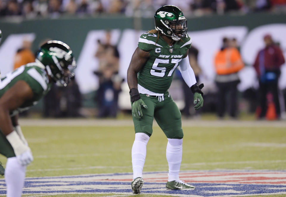 FILE - In this Oct. 21, 2019, file photo, New York Jets inside linebacker C.J. Mosley gets ready for a play by the New England Patriots during the first half of an NFL football in East Rutherford, N.J. Mosley is feeling healthy and ready to be a force again in the middle of the Jets' defense. The star middle linebacker missed almost all of last year in his first season with his new team because of a groin/core muscle injury. But, Mosley has been given a good report from the doctors, and expects to have no limitations during training camp. (AP Photo/Bill Kostroun, File)