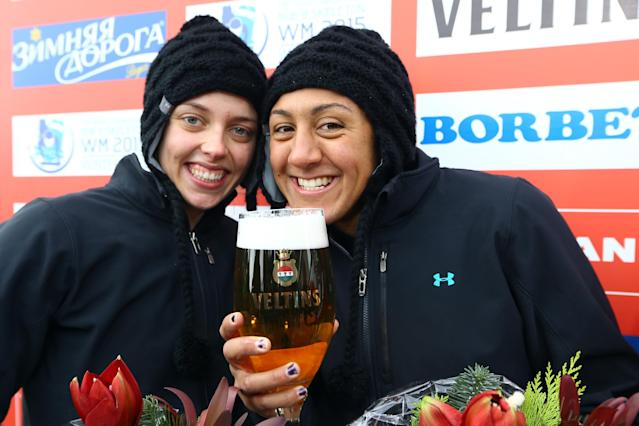 WINTERBERG, GERMANY - DECEMBER 08: Elana Meyers (R) and Katie Eberling of United States celebrate their second place during the two women's bob competition during the FIBT Bob & Skeleton World Cup at Bobbahn Winterberg on December 8, 2012 in Winterberg, Germany. (Photo by Christof Koepsel/Bongarts/Getty Images)