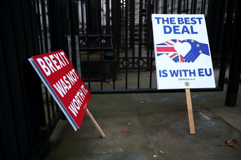 Anti-Brexit signs are pictured at the gates of Downing Street in London
