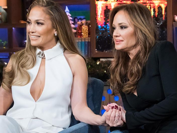 """Jennifer Lopez and Leah Remini sitting in chairs during an appearance on """"Watch What Happens Live."""""""