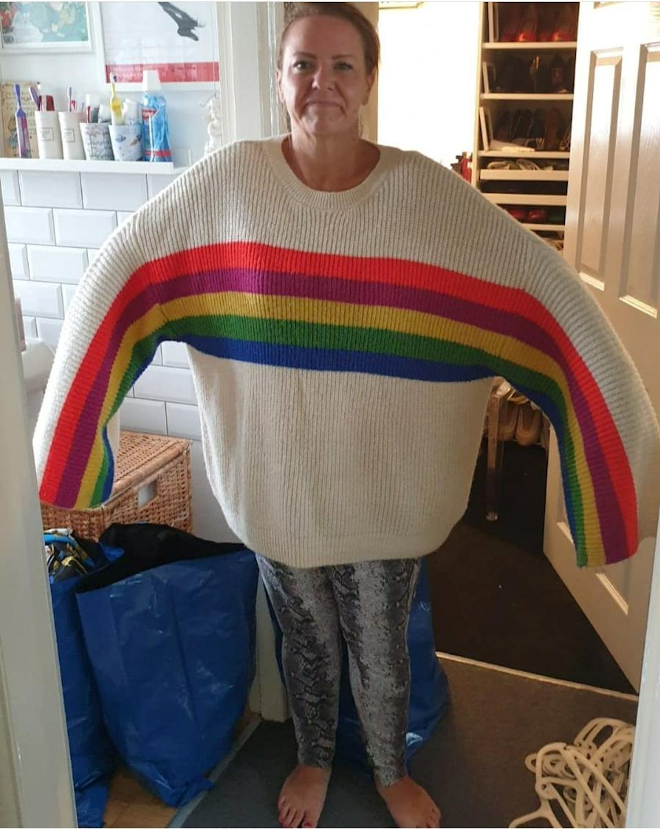 Emma wearing a jumper she used to wear before her weight loss.  (SWNS)
