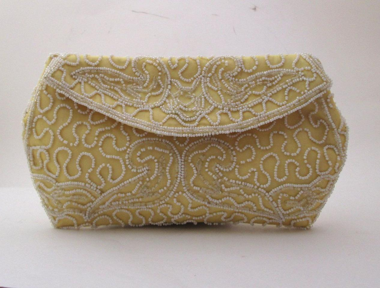 <p>Hilde Weinberg, one of the most famous handbag designers in the mid-1900s, created this delicately beaded yellow clutch in the 1950s. </p>