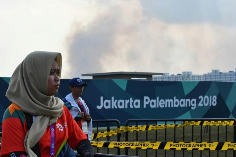 Firefighters scrambled to prevent clouds of smoke affecting Asian Games events in Palembang