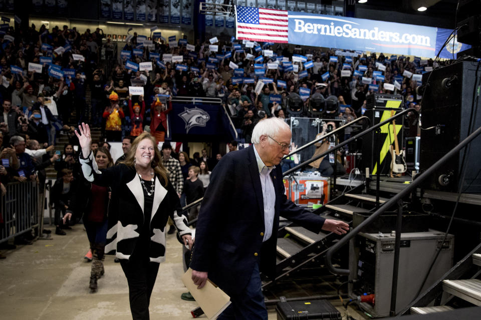 Democratic presidential candidate Sen. Bernie Sanders, I-Vt., and his wife Jane Sanders, left, take the stage for a campaign stop at the Whittemore Center Arena at the University of New Hampshire, Monday, Feb. 10, 2020, in Durham, N.H. (AP Photo/Andrew Harnik)