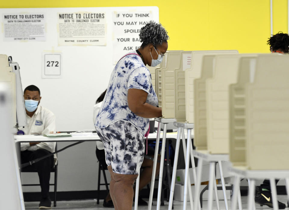 Jennifer Johnson, 61, of Detroit, votes at the Detroit Service Learning Academy in the state's primary election, Tuesday morning, Aug. 3, 2021, in Detroit. (Clarence Tabb Jr./Detroit News via AP)